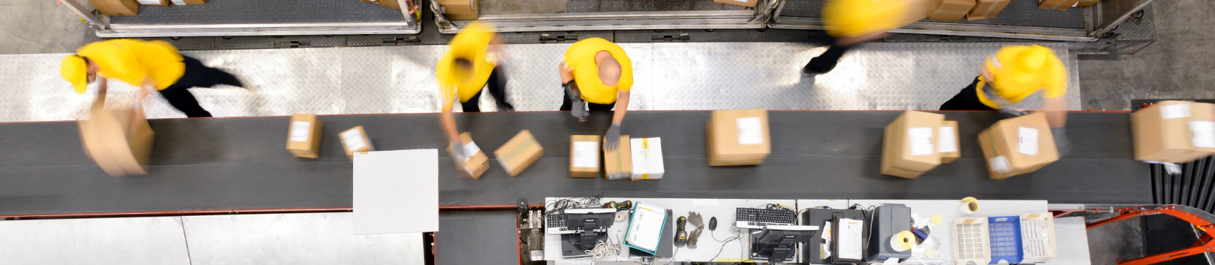 factory workers packing boxes