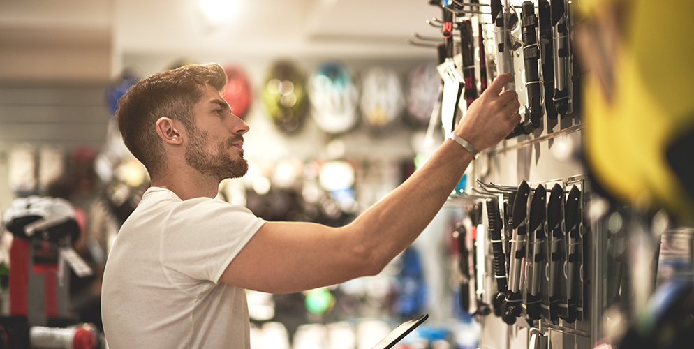 man shopping at sporting goods store